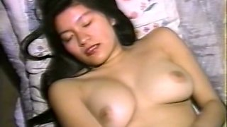 Hot and sexy brunette young babe on the bed fingers and toys herself