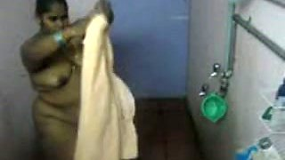 Fat Indian girl washes her body in the bathroom in hidden cam clip