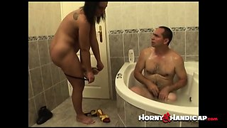 Hot slut gets banged inside a bathtub by handicap guy