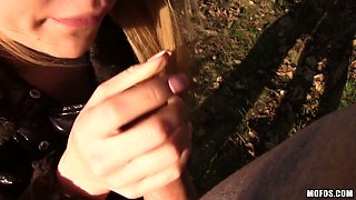 Shameless chick Nikky Dream shows her tits and gives outdoor blowjob