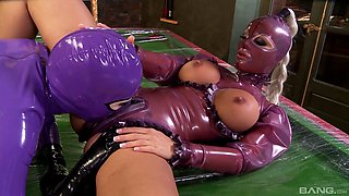 Pair of fetching senoritas in latex clothes having fun with each other