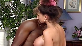 Exquisite and beautiful busty brunette receives cunnilingus from a black guy