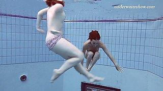 Redhead Russian lesbian shading bikini before swimming