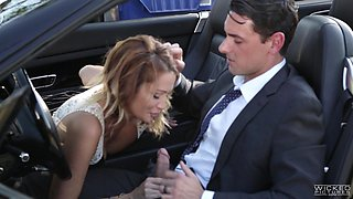 Jessica Drake sucks a fellow's cock while being in a car