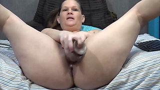 Chunky dirty talking MILF Taz masturbates pierced wet pussy