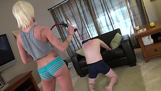 Hot blonde young mistress whipping her slave