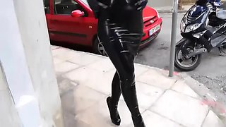 Black latex dress and very high heels