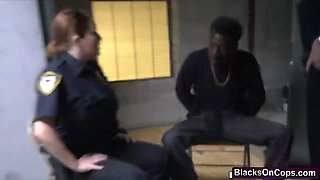 Black stud gets arrested and abused by busty cops