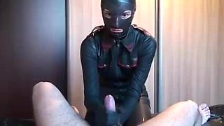 Latex Danielle play in latex mask with his toy