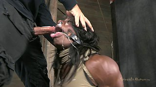 Slave ebony widened legs then having her pussy fingered in BDSM