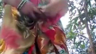 INDIAN AUNTY SHOWING BOOBS AND PUSSY IN THE JUNGLE