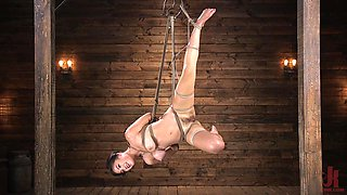 Kendra Spade hanged upside down and has her tits clamped and abused