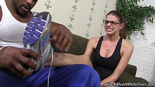 Glasses girl Brooklyn Chase gives a perfect footjob