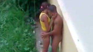 Young Brazilian couple having sex over my house outdoors