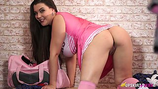 Full bodied cheerleader Cherry Blush posing on camera