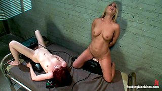 Blonde and redhead chicks use fucking machines in a prison