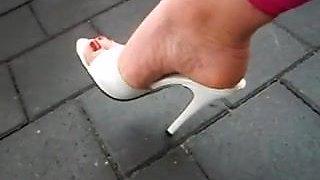 Ellise Brown in high heels dangle