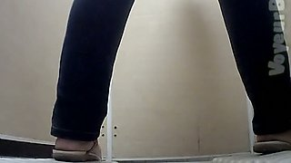 Pale skin booty of a stranger lady in jeans filmed nude in the toilet