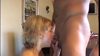 Big tits milf in glasses has her eager twat pounded on a table hardcore