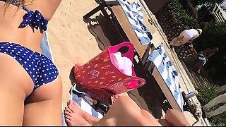 Beach voyeur finds a lovely blonde teen in a tight bikini